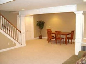 this finished basement has room for guests at holiday eating time!