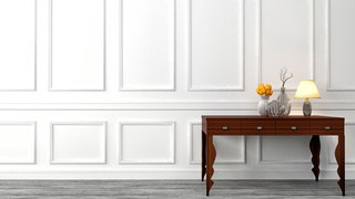 wainscoting usually covers the bottom half of a wall.
